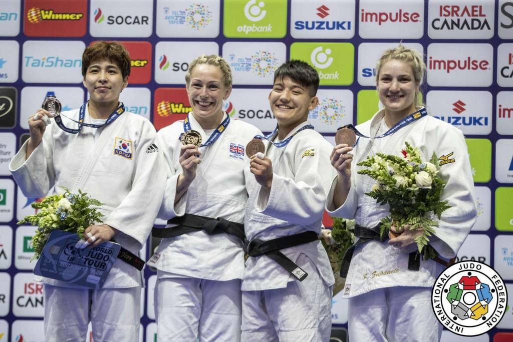 70kg級メダリスト。左から2位のキム・ソンヨン、優勝のサリー・コンウェイ、3位のアイ・ツノダ=ロウスタントとグルノザ・マトニヤゾワ。