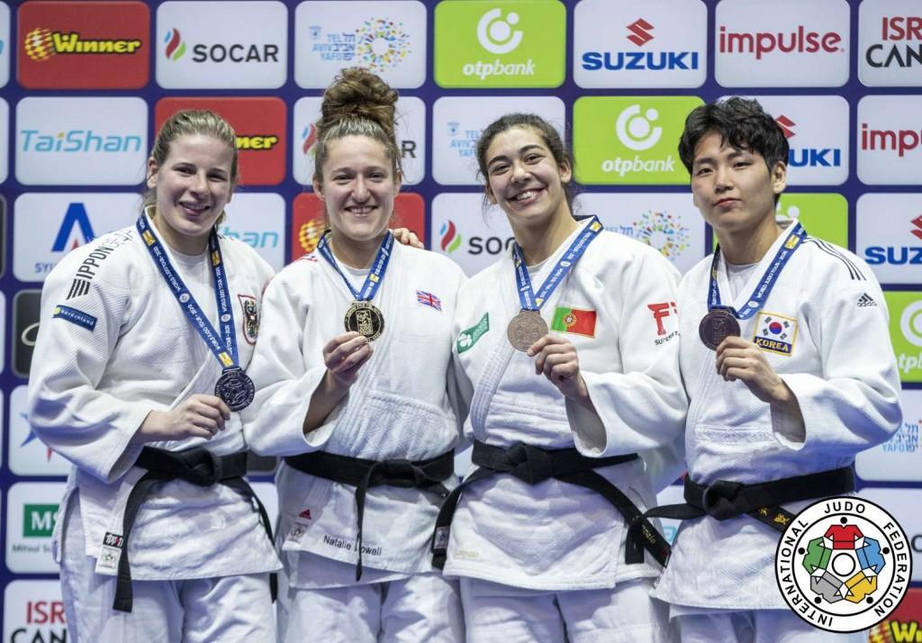 78kg級メダリスト。左から2位のベルナデッテ・グラフ、優勝のナタリー・パウエル、3位のパトリシア・サンパイオとユン・ヒュンジ。